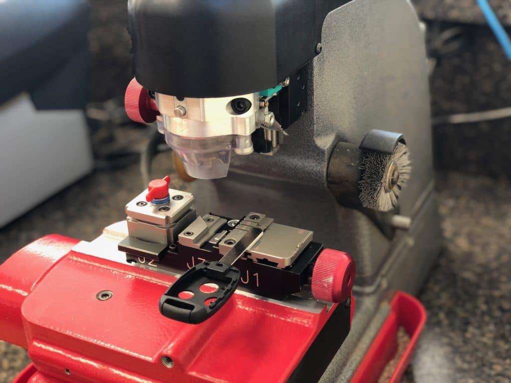 automotive key being cut on a professional key cutting machine